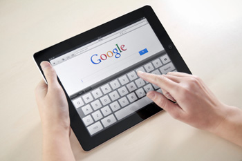 image of an author's hands on an ipad