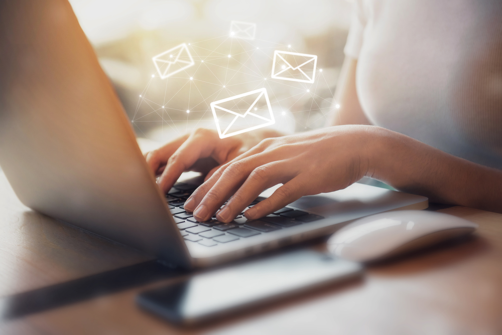 Image of a woman sending an email